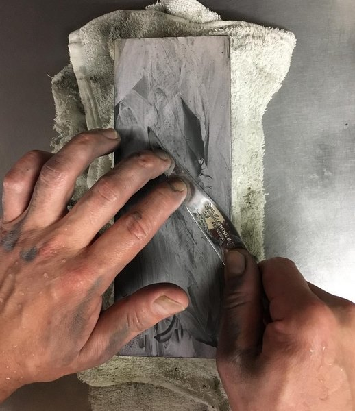 sharpening the blade of a laguiole knife